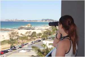 Sunburned shoulders and messy hair... Binoculars allowed us to see the whales better!